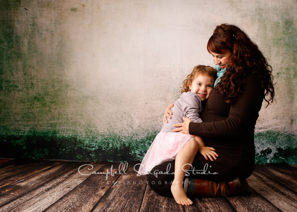 Portrait of pregnant mother and daughter on abandoned concrete background by family photographers at Campbell Salgado Studio, Portland, Oregon.