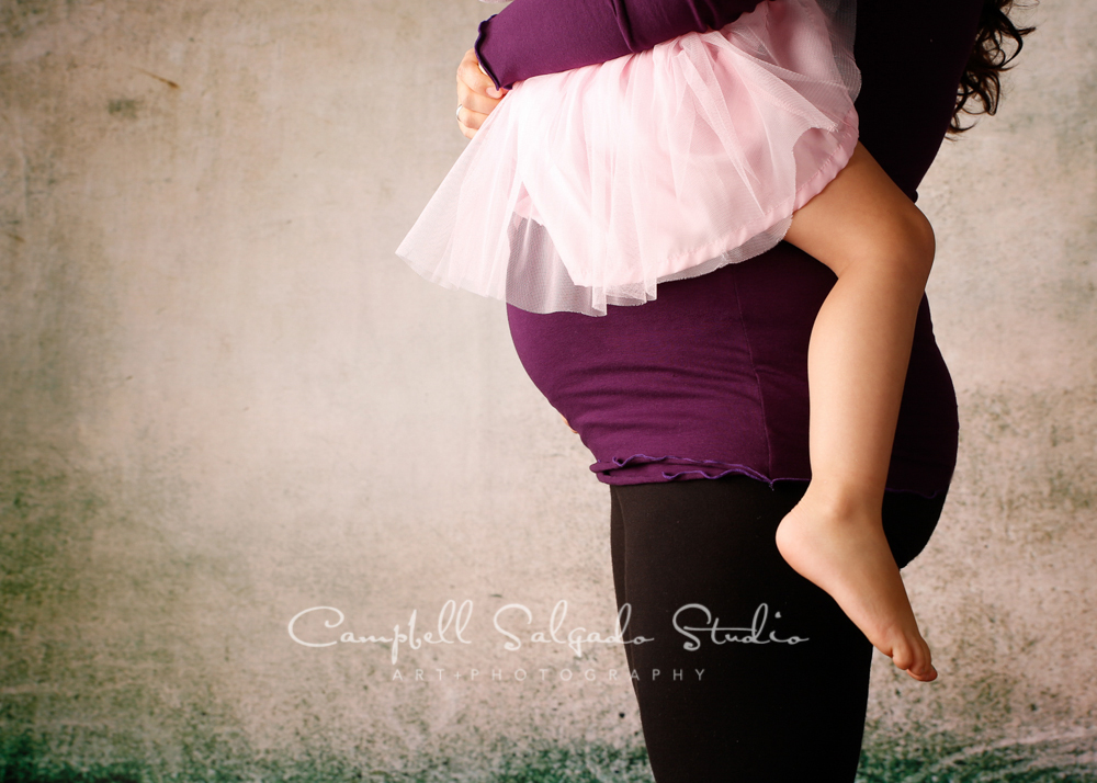 Portrait of pregnant mother and child on abandoned concrete background by maternity photographers at Campbell Salgado Studio, Portland, Oregon.