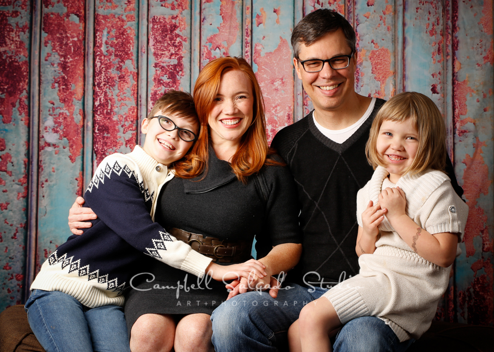 Portrait of family on italian rust backgroundby family photographers at Campbell Salgado Studio, Portland, Oregon.
