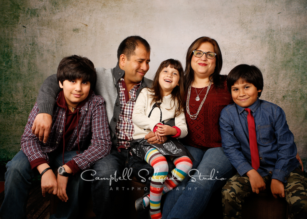 Portrait of family on abandoned concrete background by family photographers at Campbell Salgado Studio, Portland, Oregon.