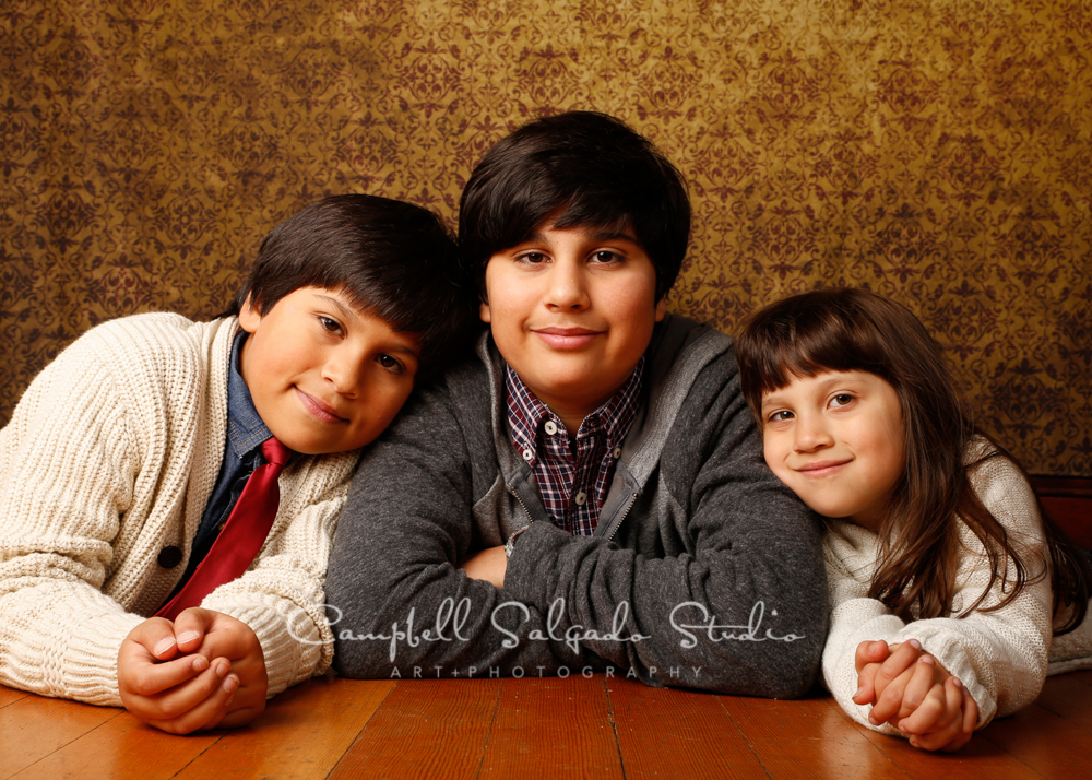 Portrait of kids on amber light background by children's photographers at Campbell Salgado Studio, Portland, Oregon.