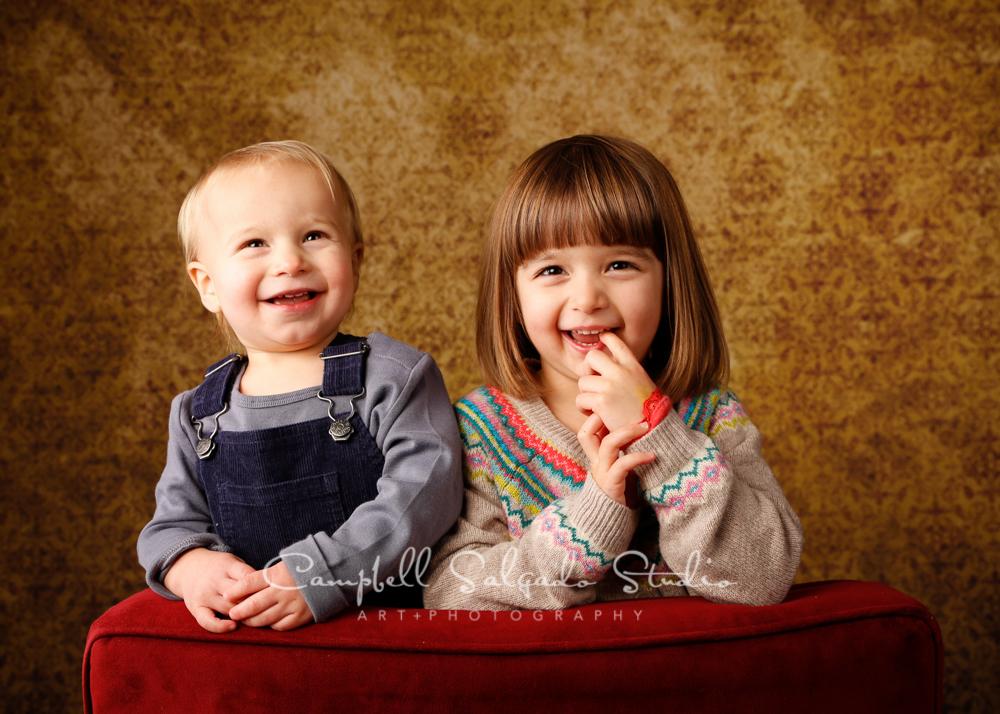 Portrait of children on amber light backgroundby child photographers at Campbell Salgado Studio, Portland, Oregon.