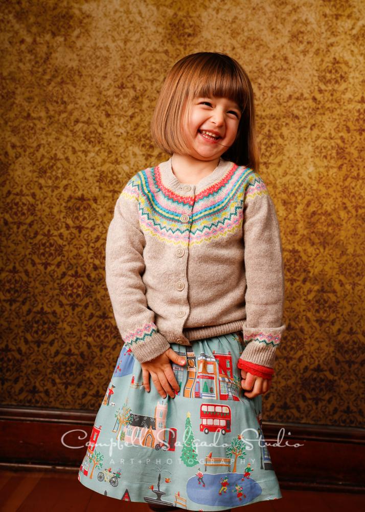 Portrait of girl on amber light backgroundby child photographers at Campbell Salgado Studio, Portland, Oregon.