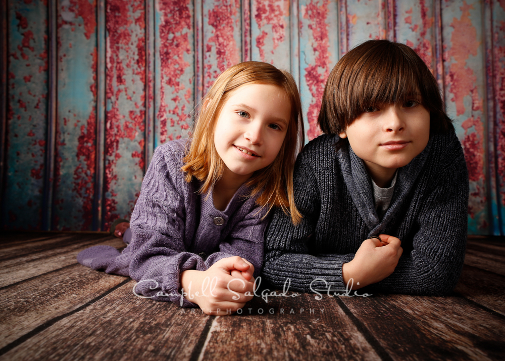 Portrait of children on italian rust background by child photographers at Campbell Salgado Studio, Portland, Oregon.