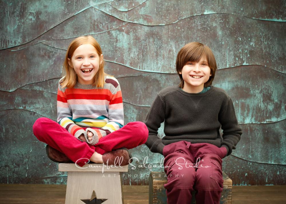 Portrait of children on copper wave backgroundby child photographers at Campbell Salgado Studio, Portland, Oregon.