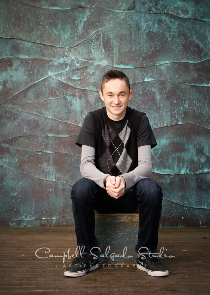 Portrait of teen on copper wave background by childrens photographers at Campbell Salgado Studio, Portland, Oregon.