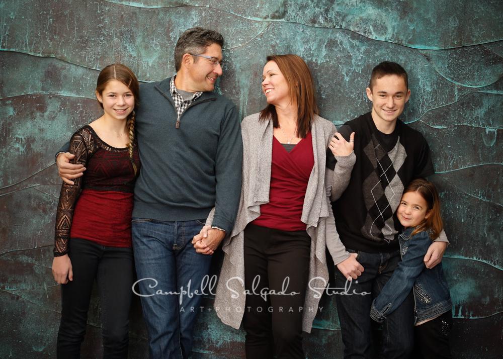 Portrait of family on copper wave backgroundby family photographers at Campbell Salgado Studio, Portland, Oregon.