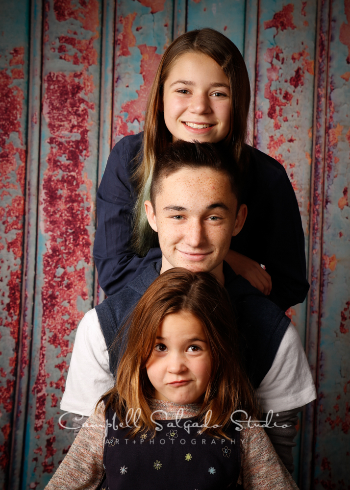 Portrait of siblings on italian rust background by childrens photographers at Campbell Salgado Studio, Portland, Oregon.