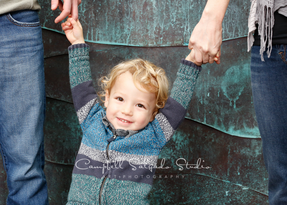 Portrait of child on copper wave background by child photographers at Campbell Salgado Studio, Portland, Oregon.