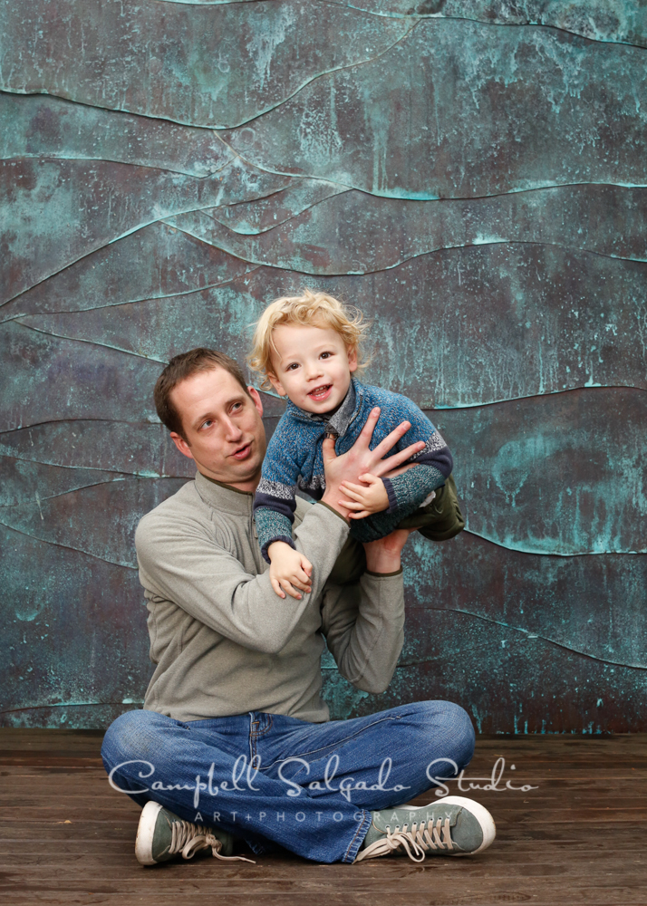 Portrait of father and son on copper wave background by family photographers at Campbell Salgado Studio, Portland, Oregon.