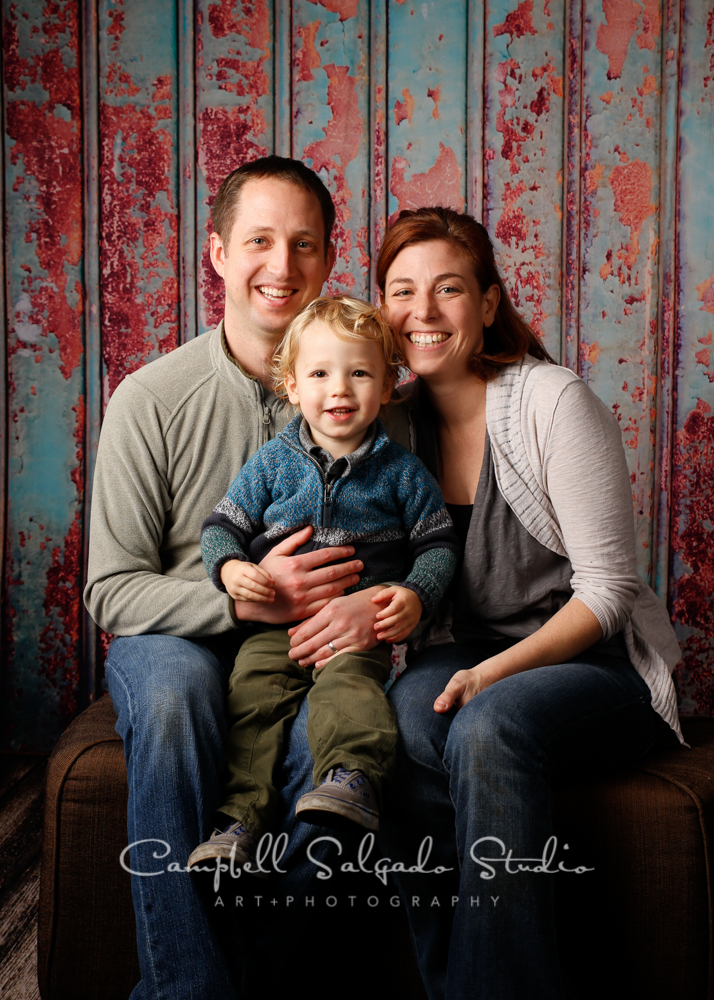 Portrait of family on italian rust background by family photographers at Campbell Salgado Studio, Portland, Oregon.