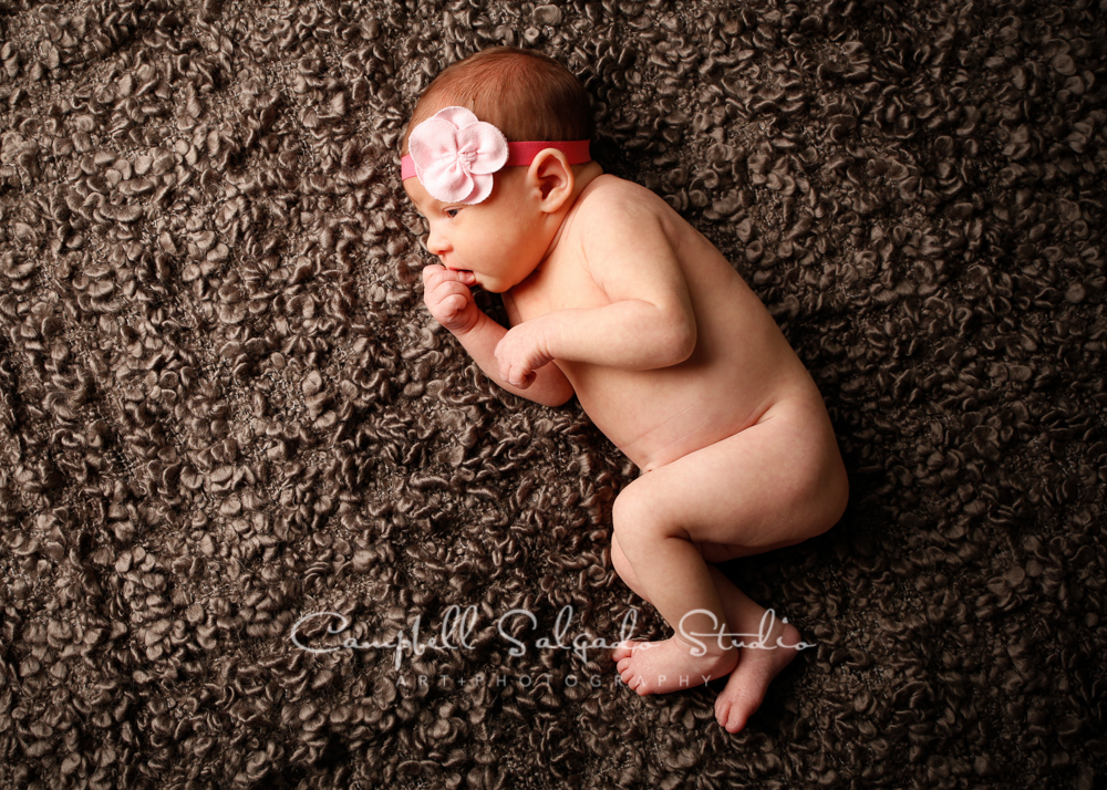 Portrait of baby on grey blankie by newborn photographers at Campbell Salgado Studio, Portland, Oregon.