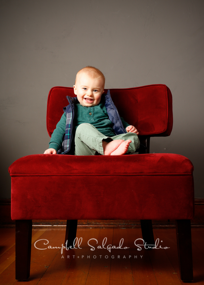 Portrait of child on grey background by child photographers at Campbell Salgado Studio, Portland, Oregon.