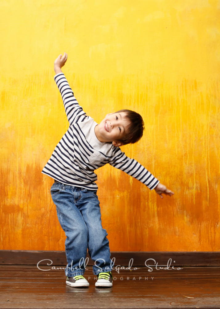 Portrait of boy on liquid sunshine background by child photographers at Campbell Salgado Studio, Portland, Oregon.