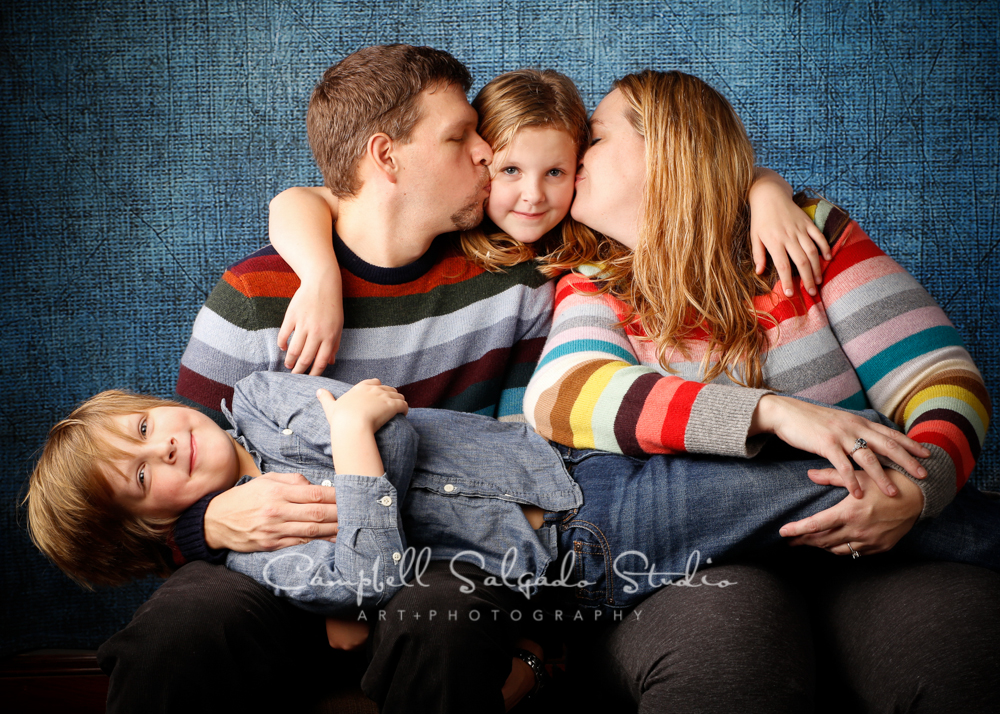 Portrait of family on denim background by family photographers at Campbell Salgado Studio, Portland, Oregon.