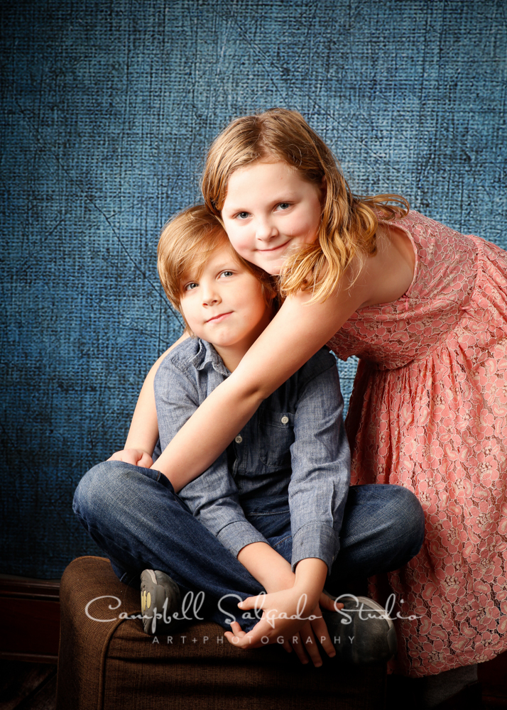 Portrait of kids on denim background by child photographers at Campbell Salgado Studio, Portland, Oregon.