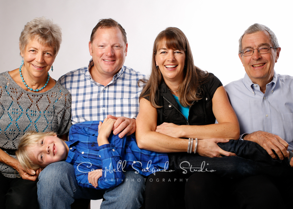 Portrait of multi-generational family on white background by family photographers at Campbell Salgado Studio, Portland, Oregon.
