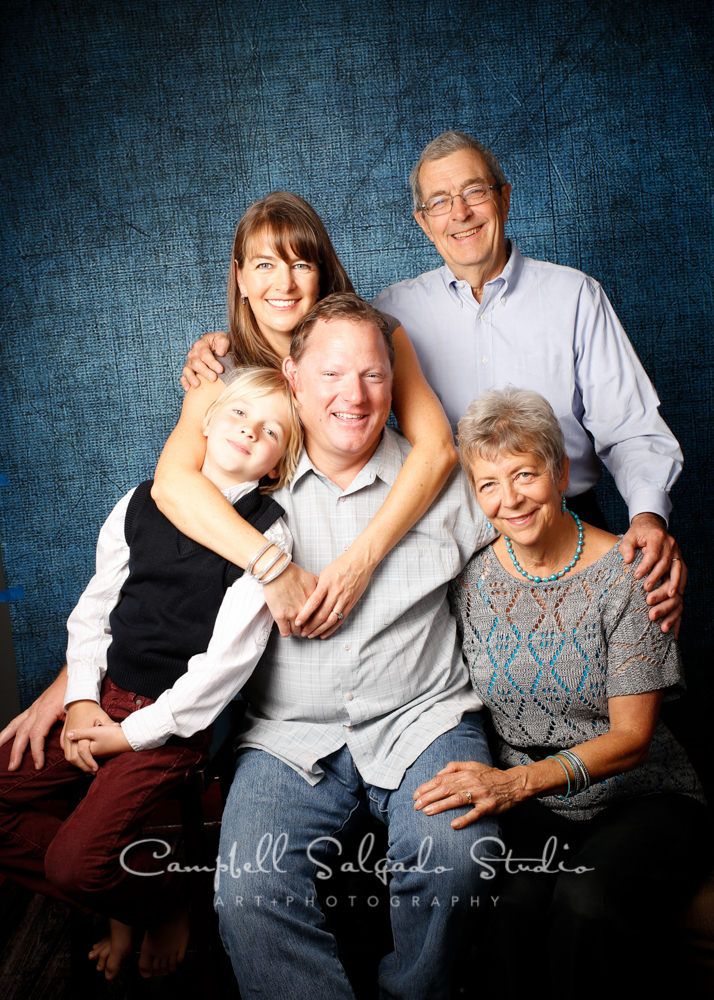 Portrait of multigenerational family on denim background by family photographers at Campbell Salgado Studio, Portland, Oregon.
