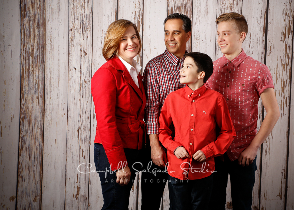 Portrait of family on white fence boards background by family photographers at Campbell Salgado Studio, Portland, Oregon.