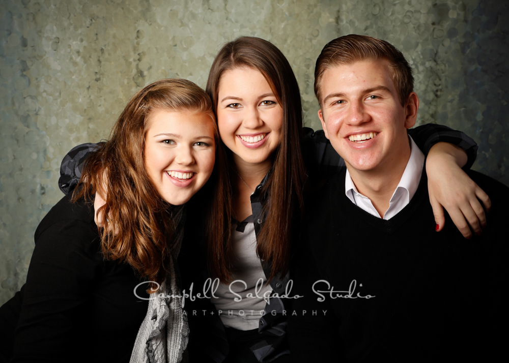 Portrait of siblings on rain dance background by family photographers at Campbell Salgado Studio, Portland, Oregon.