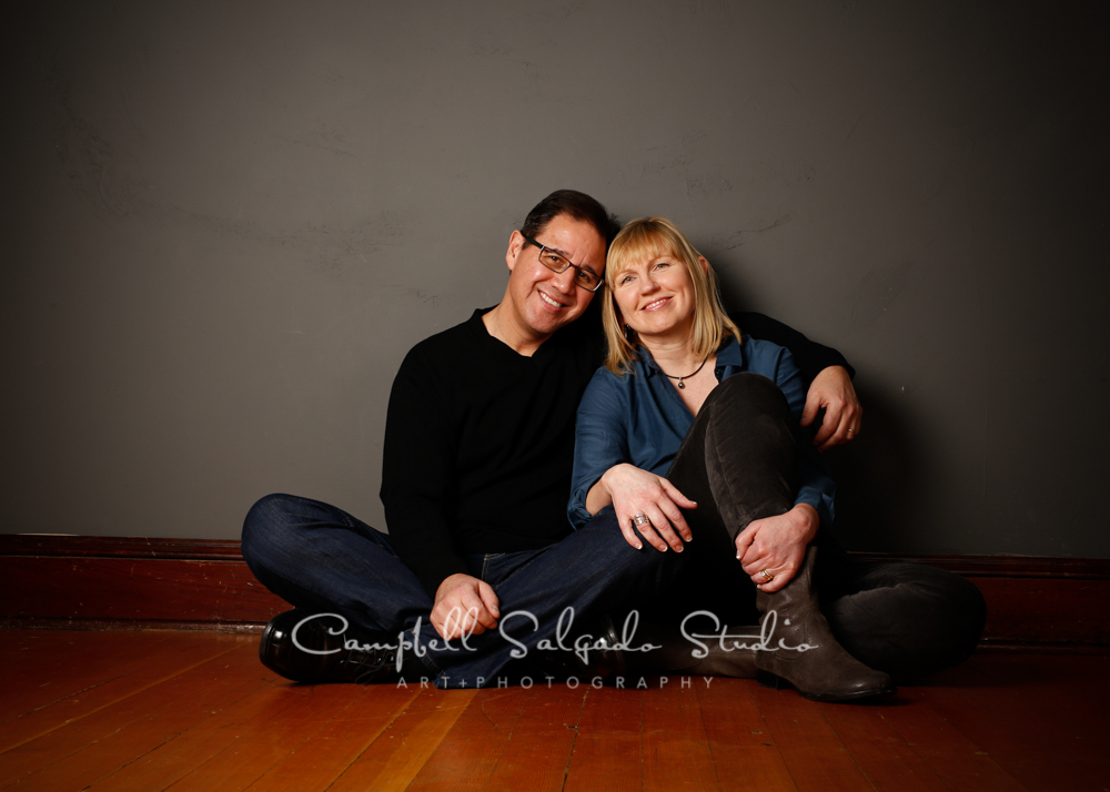 Portrait of couple on grey background by family photographers at Campbell Salgado Studio, Portland, Oregon.