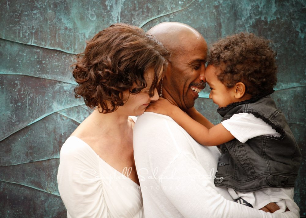 Portrait of family on copper wave background by family photographers at Campbell Salgado Studio, Portland, Oregon.