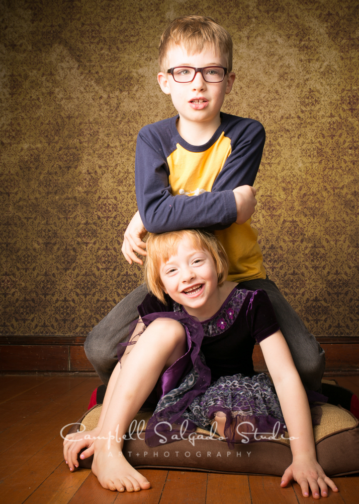 Portrait of kids on amber light background by family photographers at Campbell Salgado Studio, Portland, Oregon.
