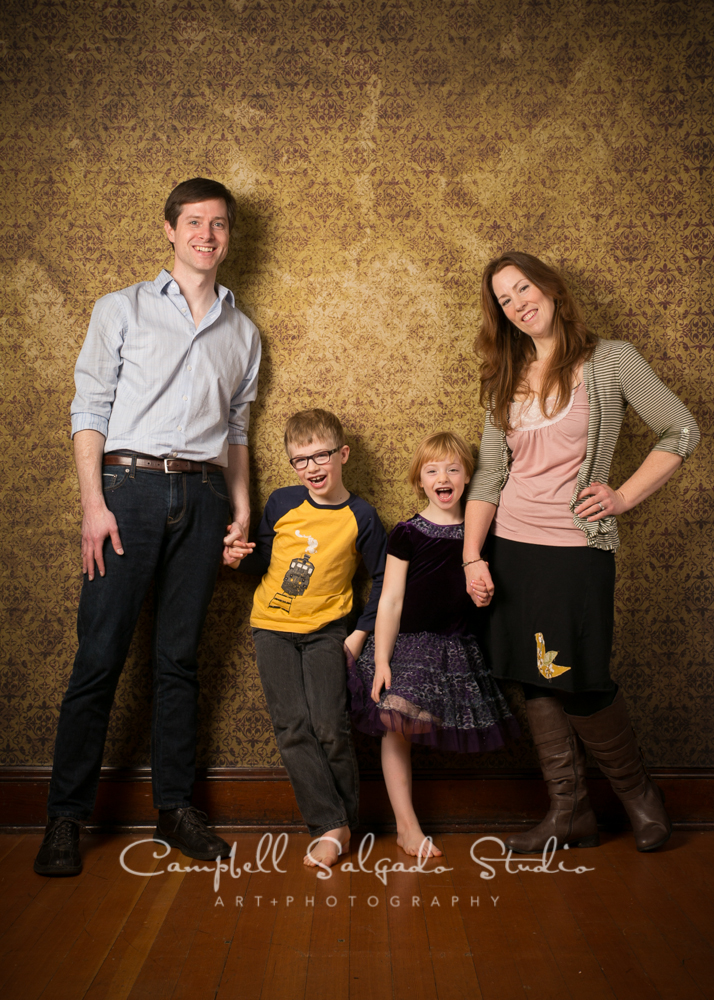 Portrait of family on amber light background by family photographers at Campbell Salgado Studio, Portland, Oregon.