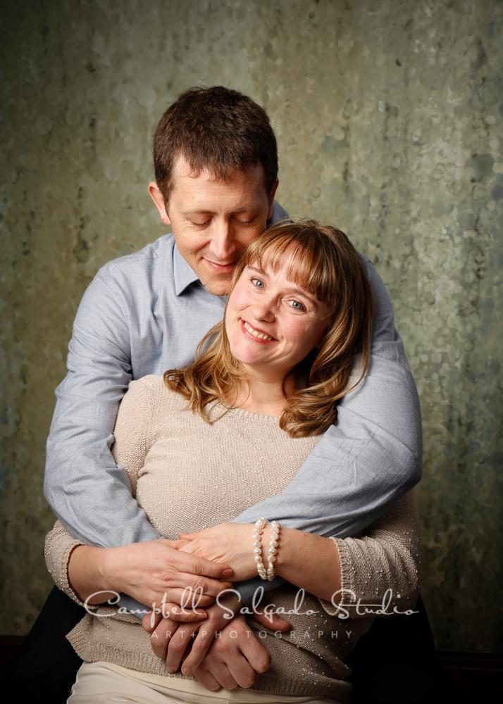 Portrait of couple on rain dance backgroundby family photographers at Campbell Salgado Studio, Portland, Oregon.