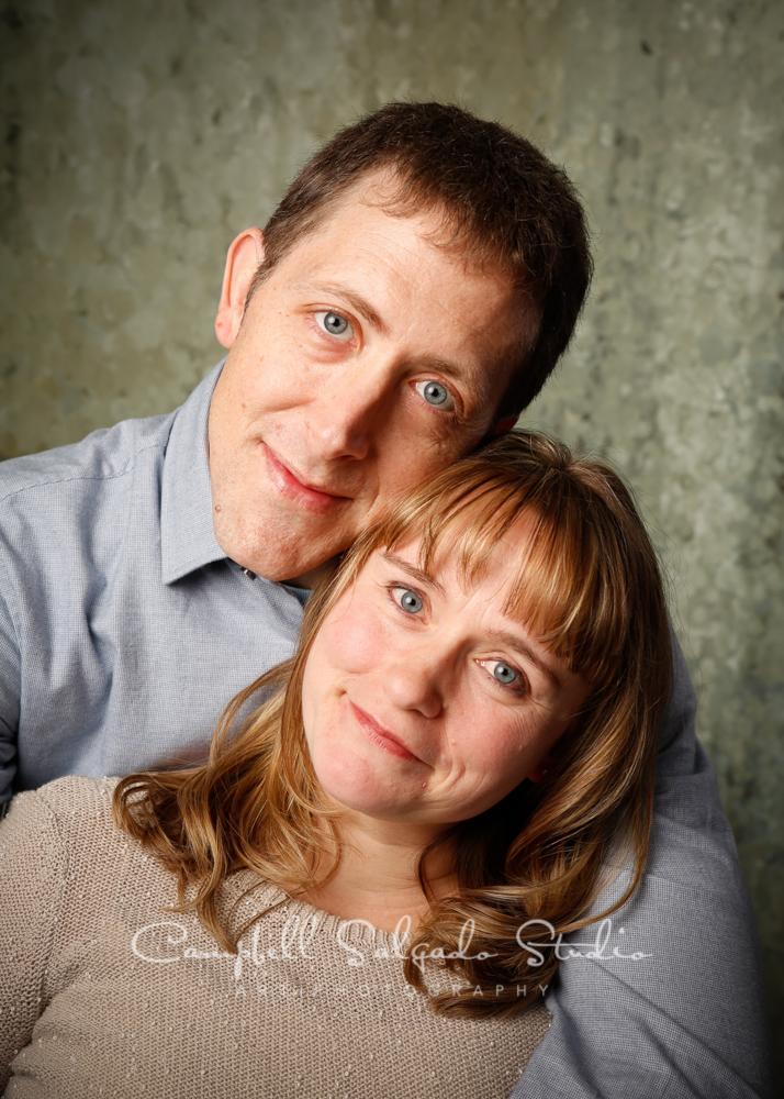 Portrait of couple on rain dance backgourndby family photographers at Campbell Salgado Studio, Portland, Oregon.