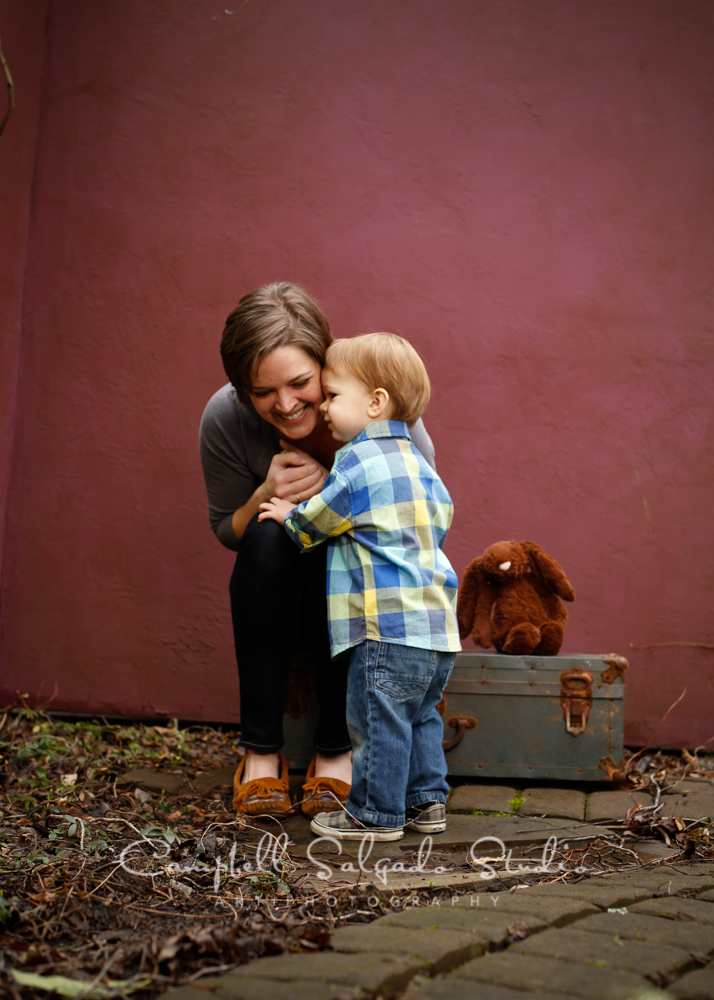Portrait of child and mama on plum stucco background by child photographers at Campbell Salgado Studio, Portland, Oregon.