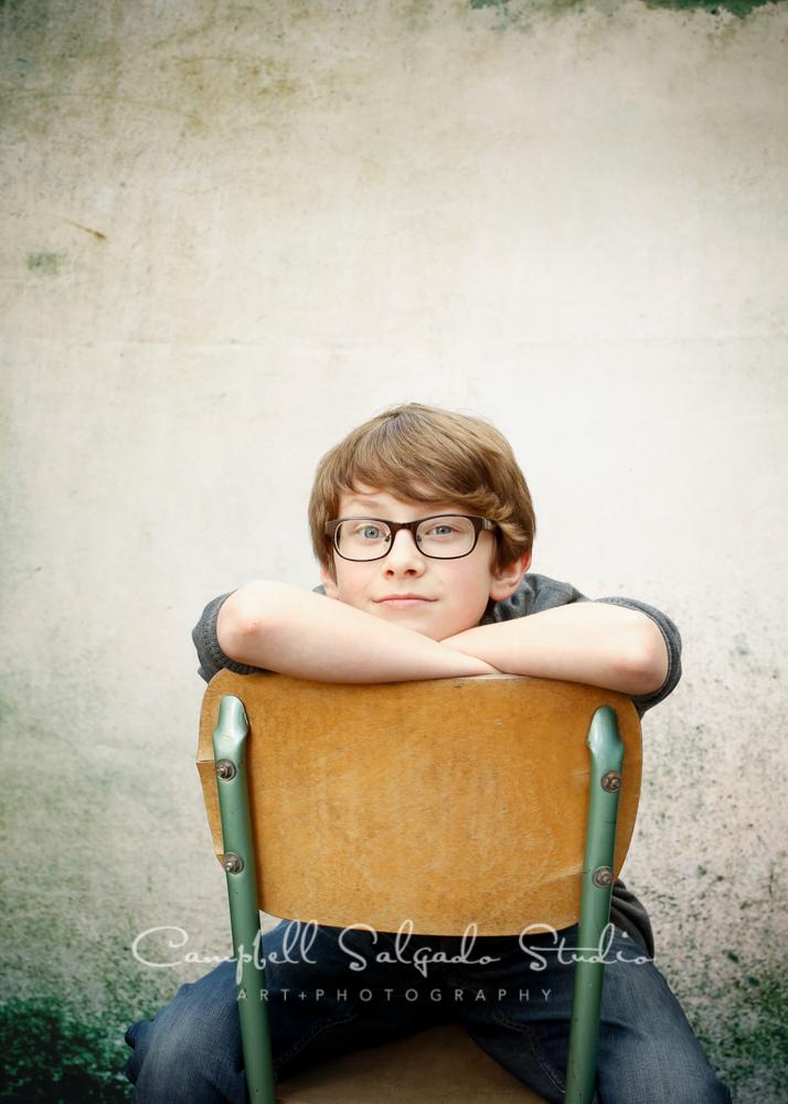 Portrait of boy on abandoned concrete backgroundby child photographers at Campbell Salgado Studio, Portland, Oregon.