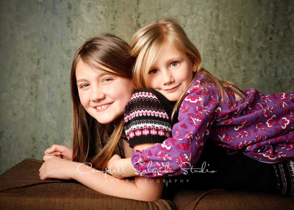 Portrait of sisters on rain dance background by childrens photographers at Campbell Salgado Studio, Portland, Oregon.