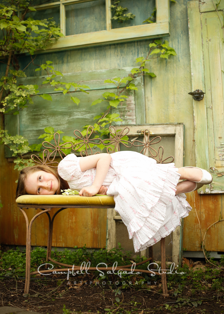Portrait of child on vintage doors backgroundby childrens photographers at Campbell Salgado Studio, Portland, Oregon.