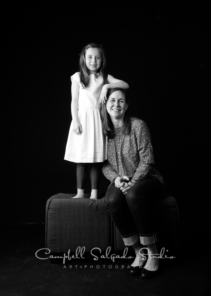 B&W portrait of mother and daughter on black background  by family photographers at Campbell Salgado Studio, Portland, Oregon.