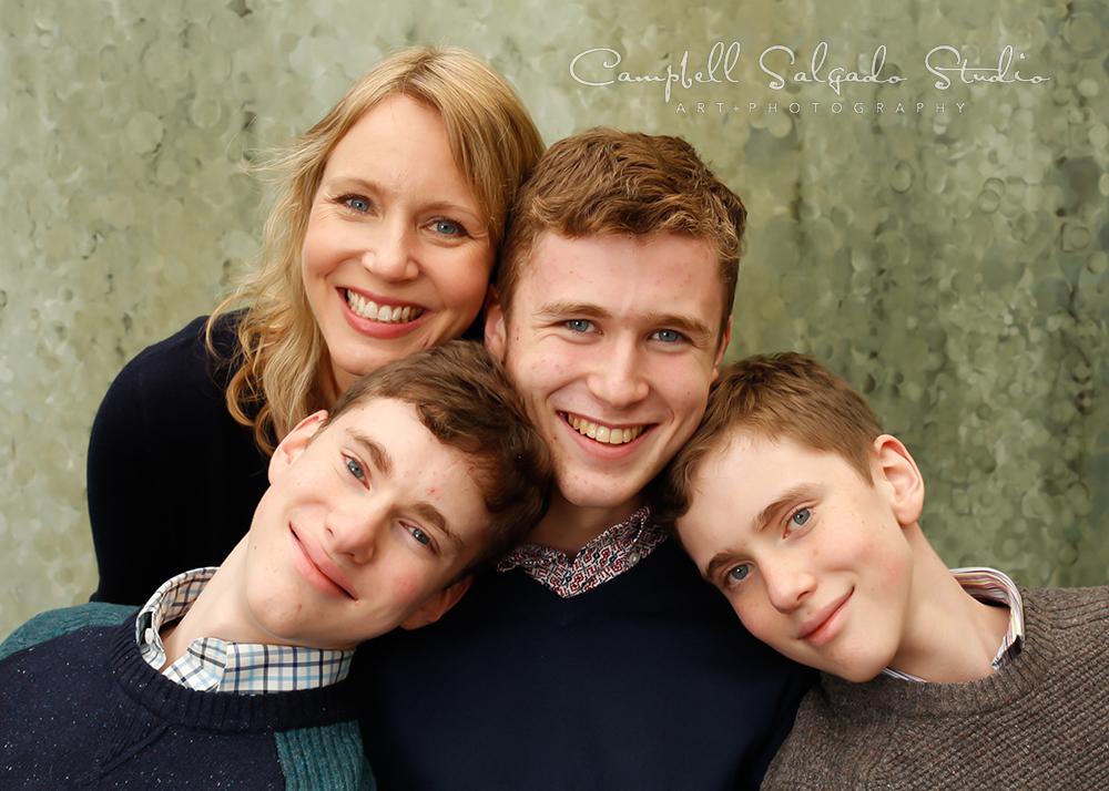 Portrait of family on rain dance backgroundby family photographers at Campbell Salgado Studio, Portland, Oregon.