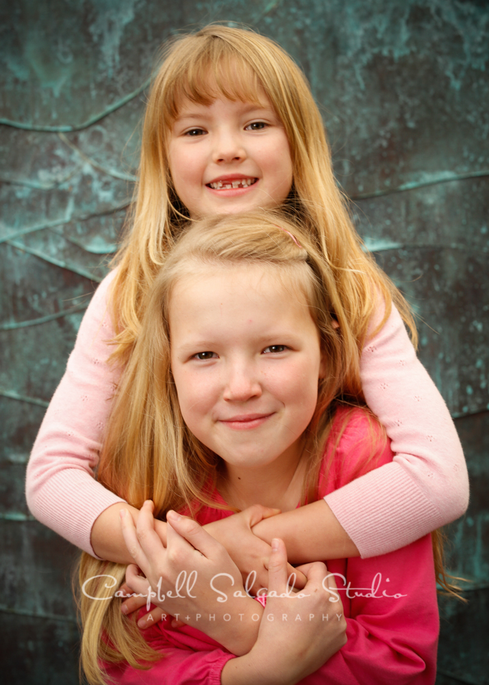 Portrait of girls on copper wave background by child photographers at Campbell Salgado Studio, Portland, Oregon.