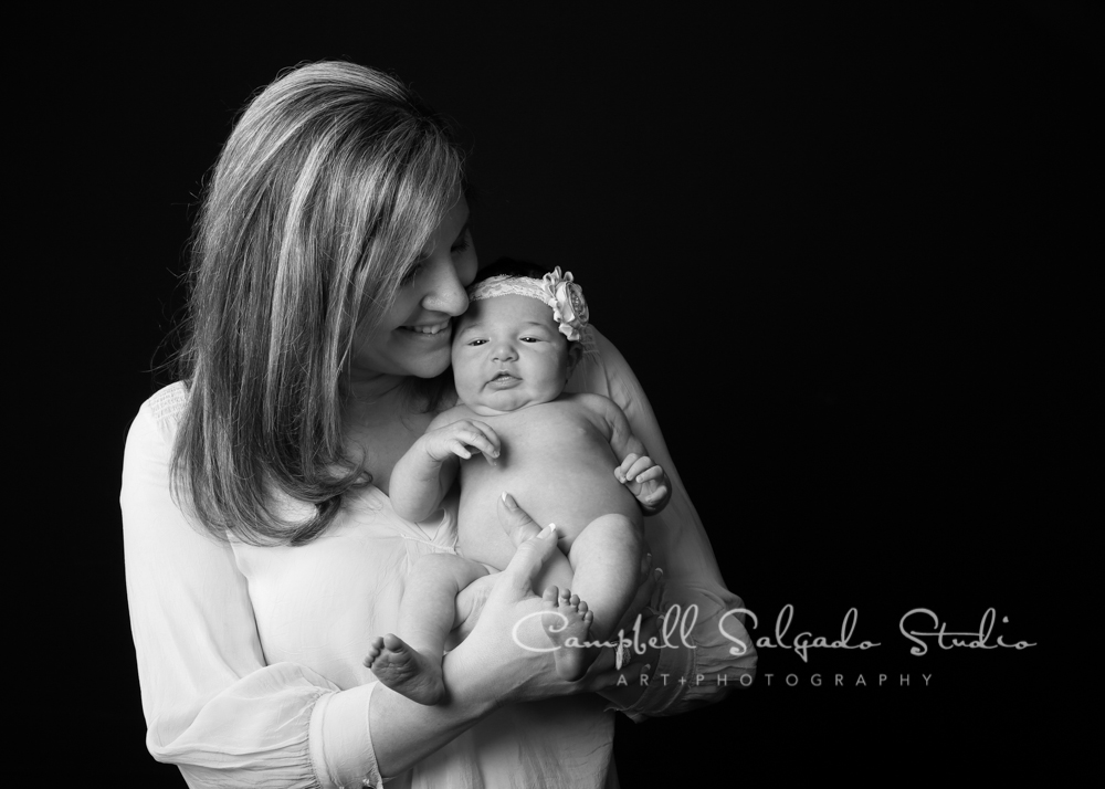 B&W portrait of mother and baby on black background by family photographers at Campbell Salgado Studio, Portland, Oregon.