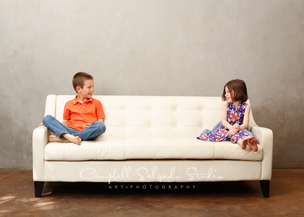 Portrait of kids on modern grey background by family photographers at Campbell Salgado Studio, Portland, Oregon.
