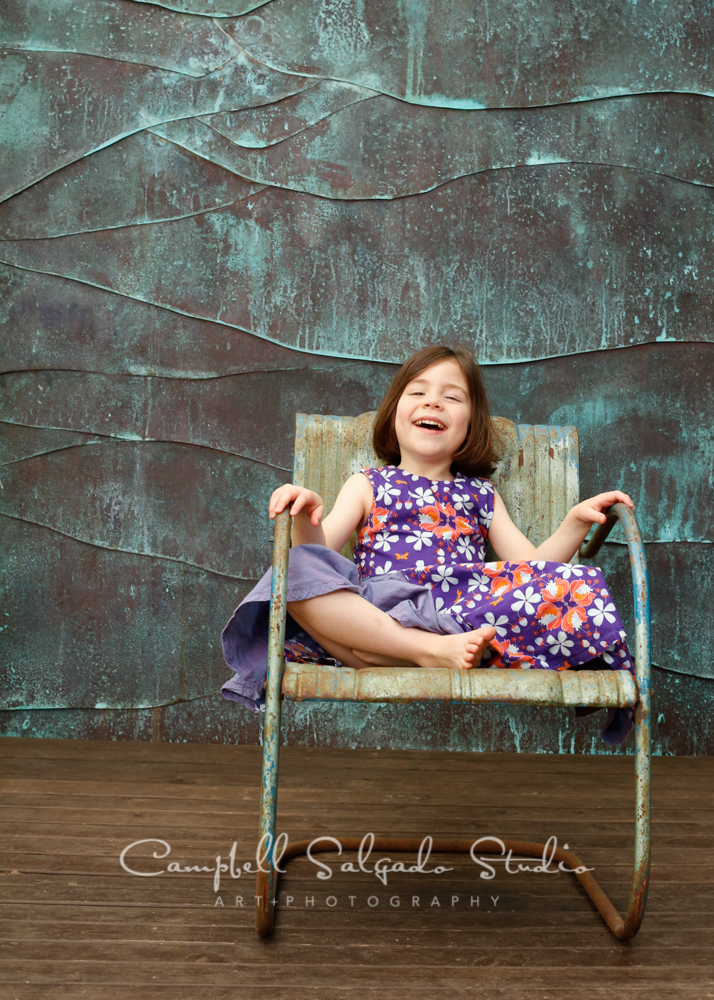 Portrait of girl on copper wave background by child photographers at Campbell Salgado Studio, Portland, Oregon.
