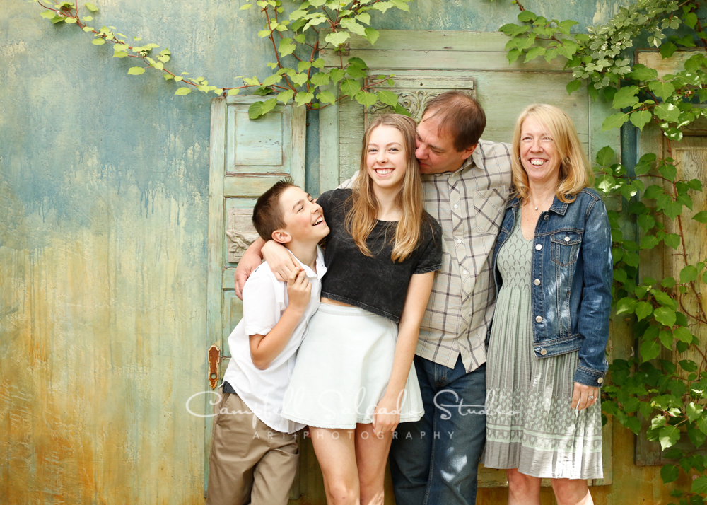 Portrait of family on vintage green doors background by family photographers at Campbell Salgado Studio, Portland, Oregon.