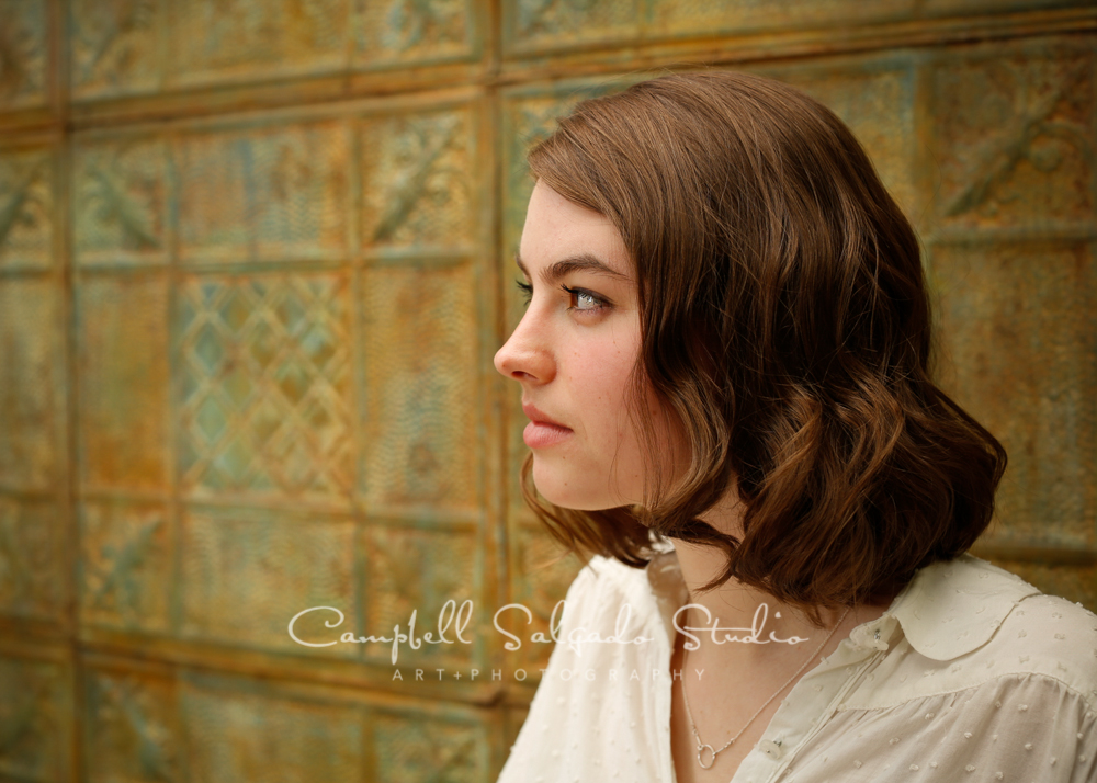 Portrait of girl on vintage colored tin background by family photographers at Campbell Salgado Studio, Portland, Oregon.