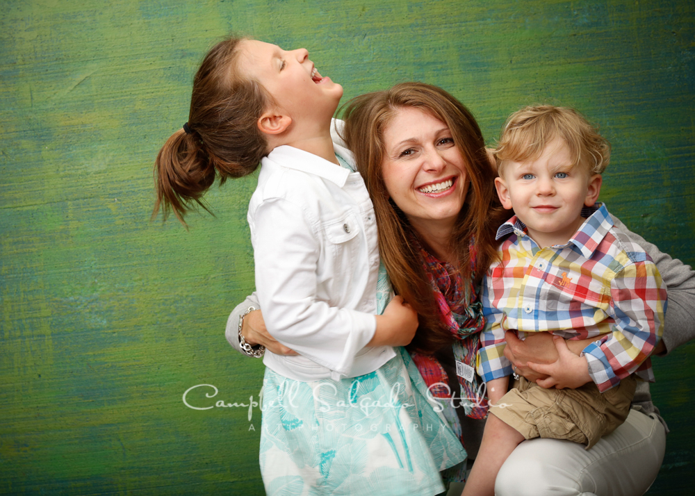 Portrait of family on blue green weave background by family photographers at Campbell Salgado Studio, Portland, Oregon