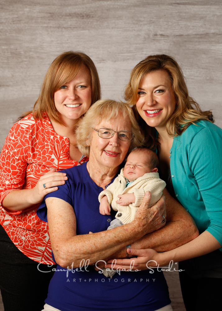 Multigenerational portrait of family with newborn on graphite background by newborn photographers at Campbell Salgado Studio, Portland, Oregon.