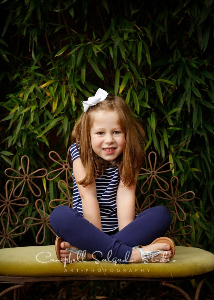 Portrait of child on bamboobackgroundby childrens photographers at Campbell Salgado Studio, Portland, Oregon.
