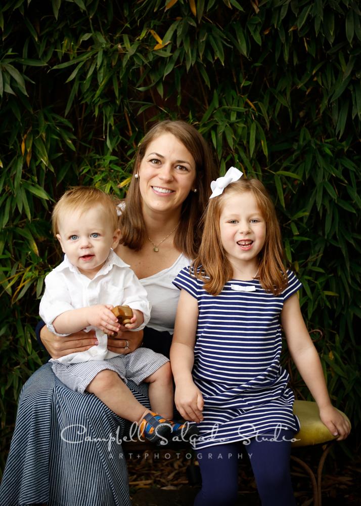 Portrait of familyon bamboobackgroundby familyphotographers at Campbell Salgado Studio, Portland, Oregon.