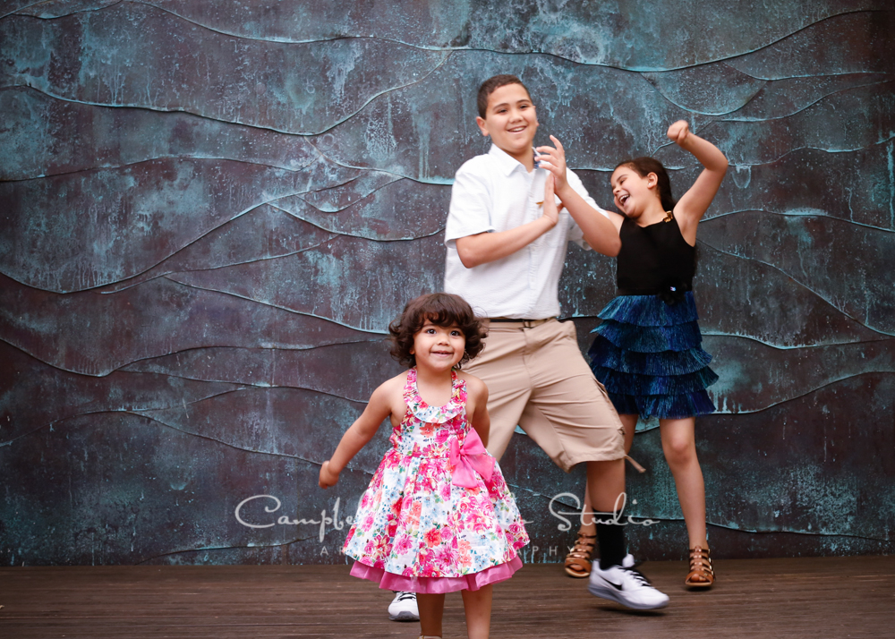 Portrait of kids on copper wave background by children's photographers at Campbell Salgado Studio, Portland, Oregon.