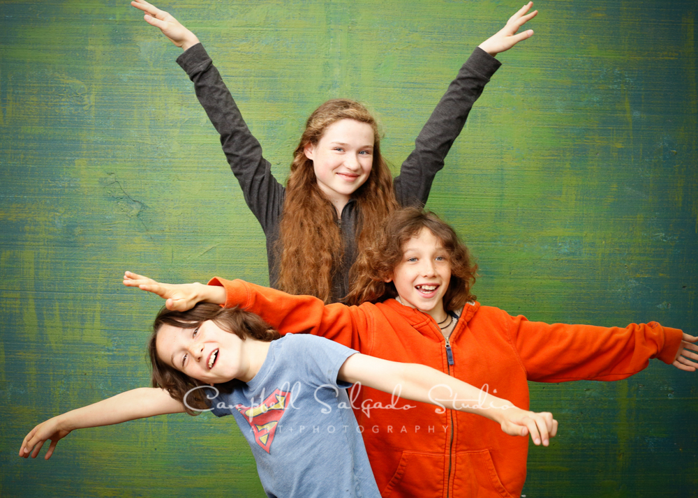Portrait of siblings on blue green weave background by child photographers at Campbell Salgado Studio, Portland, Oregon.