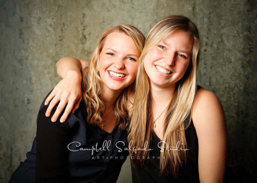 Portrait of sisters on rain dance background by family photographers at Campbell Salgado Studio, Portland, Oregon.