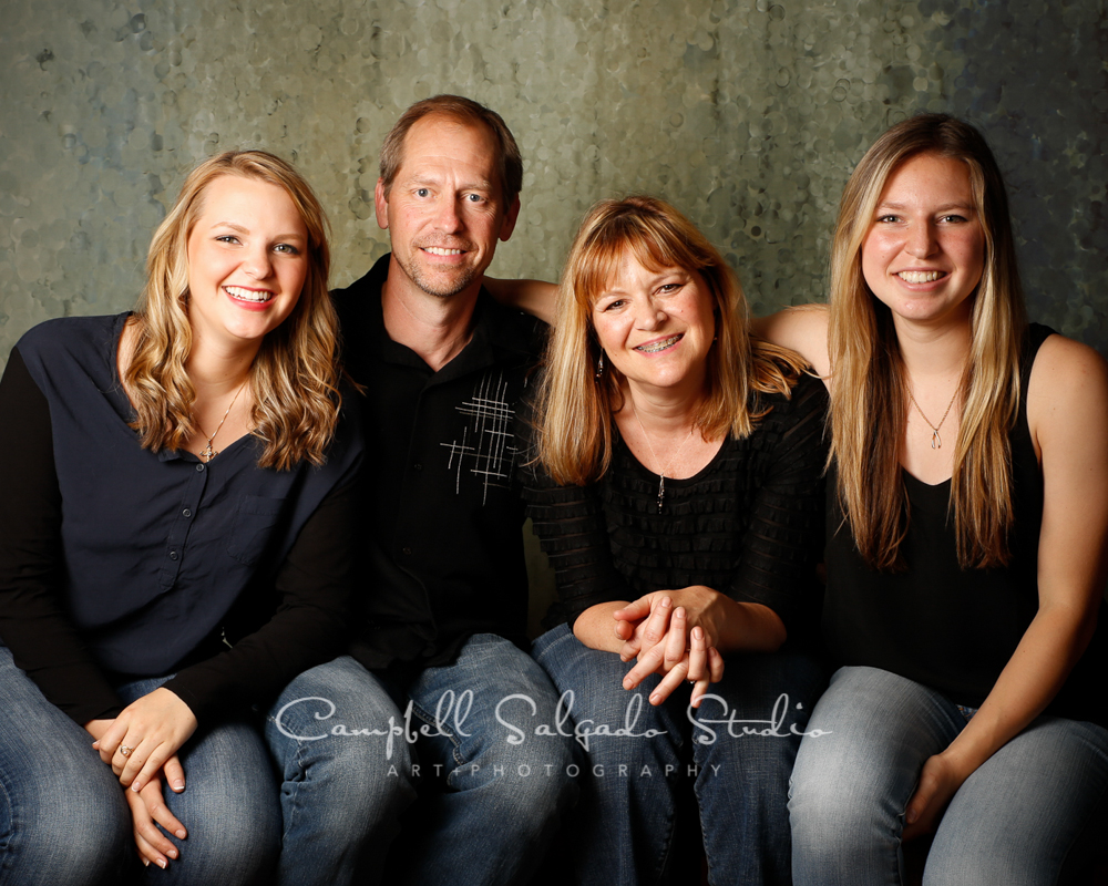 Portrait of family on rain dance background by family photographers at Campbell Salgado Studio, Portland, Oregon.
